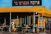 Israelis at a gas station/cafeteria rest stop on Highway 90 (the longest road in Israel) in the Negev Desert, Israel.
