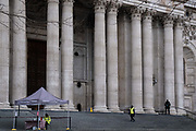 The day after the government introduced a third Coronavirus pandemic national lockdown, effectively a Tier 5 restriction, security staff wait on the cold steps of St. Pauls Cathedral for non-existent visitors as the capital experiences a grim post-Christmas and millions of Britons are told to stay at home, on 5th January 2021, in London, England.