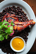 Yucatan Chicken, made with Mad Hatcher Chicken, annatto seed marinade, pickled onions and habanero hot sauce, at Poquitos on Capitol Hill. <br /> John Lok / The Seattle Times