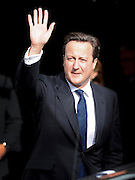 © Licensed to London News Pictures. 04/10/2011. MANCHESTER. UK. The Rt Hon David Cameron Prime Minister waves to crowds at The Conservative Party Conference at Manchester Central today, October 4, 2011. Photo credit:  Stephen Simpson/LNP