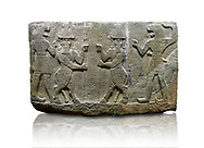 Picture & image of Hittite relief sculpted orthostat stone panel of Herald's Wall. Basalt, Karkamıs, (Kargamıs), Carchemish (Karkemish), 900-700 B.C. Anatolian Civilisations Museum, Ankara, Turkey.<br /> <br /> Protective mixed creatures. One each hand of the lion-headed men is in the form of a fist. The mace on the left is over the head of the weapon on the right. The two bull-men in the middle carry one spear each in their hands. Bull-man is known as Kusarikku, and the lion-man is known as Ugallu. <br /> <br /> Against a white background. .<br />  <br /> If you prefer to buy from our ALAMY STOCK LIBRARY page at https://www.alamy.com/portfolio/paul-williams-funkystock/hittite-art-antiquities.html  - Type  Karkamıs in LOWER SEARCH WITHIN GALLERY box. Refine search by adding background colour, place, museum etc.<br /> <br /> Visit our HITTITE PHOTO COLLECTIONS for more photos to download or buy as wall art prints https://funkystock.photoshelter.com/gallery-collection/The-Hittites-Art-Artefacts-Antiquities-Historic-Sites-Pictures-Images-of/C0000NUBSMhSc3Oo