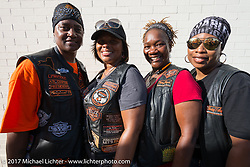 Denise Lasalle Travis (3rd from left) with three sisters of the Harley's Angels MC in Atlanta rode from the East Coast for the Lone Star Rally. Galveston, TX. USA. Saturday November 4, 2017. Photography ©2017 Michael Lichter.
