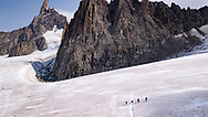 """Stomping my crampons into the crumbly ice walls, I arrested my descent into a crack on the Vallée Blanche, a sliver just wide enough to fit my body. Another hiker roped to me said, """"Most people want to avoid crevasses but Leslie climbs into one."""" Chilled inside this glacier, I paid homage to the jagged peaks of the deadly Aiguille Verte and Mont Blanc, the highest mountain in the Alps."""