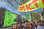 A perfect summers day for the Campaign against Climate Change's backwards march – on the governments first anniversary in power the protestestors  wanted to highlight their belief that clean energy technology has been sidelined in favour of a 'dash for gas, insulation cut and fracking, roads and runways pushed through despite strong local opposition'. They walked backwards from Traflagar Square, down Whitehall, ending at the DoH.