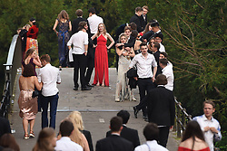Students make their way home after attending a May Ball at Cambridge University which is the traditional celebration to mark the end of the academic year.
