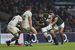 November 12, 2016 - London, England, United Kingdom - Willem Alberts of South Africa charges at Nathan Hughes and Owen Farrell of England during Old Mutual Wealth Series between England  and South Africa played at Twickenham Stadium, London, November 12th  2016  (Credit Image: © Kieran Galvin/NurPhoto via ZUMA Press)