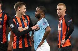 Shakhtar Donetsk's Mykola Matviyenko (left) talks to Manchester City's Raheem Sterling (centre) after the penalty is awarded
