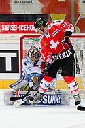 04.April 2012; Rapperswil-Jona; Eishockey - Schweiz - Finnland;<br />  Michael Liniger (SUI) gegen Torhueter Joni Ortio (FIN) (Thomas Oswald)
