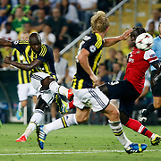 Fenerbahce's Moussa Sow (L) during the UEFA Champions League Play-Offs First leg soccer match Fenerbahce between Arsenal at Sukru Saracaoglu stadium in Istanbul Turkey on Wednesday 21 August 2013. Photo by /TURKPIX