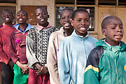 Pupils of Mathare School give a performance to the younger pupils in Nairobi, Kenya. Undugu Society of Kenya (USK) are an NGO who run various programmes that assist the school and children.