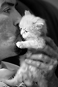 Carlos kisses his new kitten 'Sugar'.  Carlos Raposa, 49, has lived with diabetes since he was 21.  Mr. Raposa had both legs amputated from the knees down due to complications from the disease.  Mr Raposa lives in Fall River and visits his mother regularly who lives close by.  She cooks for him and helps him deal with the cripling condition he has been dealing with.  As his condition has worstened over the years Carlos has had greater difficulty dealing with his condition.  Increasingly, Carlos has fallen greater into depression and has turned to smoking and drinking to deal with it.  What used to be monthly visits to the hospital has turned into weekly excursions with ever longer stays in hospital.  Family members have become ever more worried about Carlos' drop in weight and his inability to move on his own any longer.  For someone who was an athletic figure, Carlos has become a shadow of his former self.