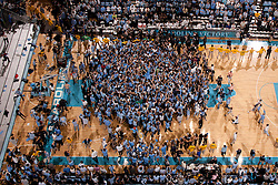CHAPEL HILL, NC - MARCH 05: An overhead general view of the Dean Smith Center court as North Carolina Tar Heels fans storm the court after beating the Duke Blue Devils on March 05, 2011 at the Dean E. Smith Center in Chapel Hill, North Carolina. North Carolina won 67-81. (Photo by Peyton Williams/UNC/Getty Images)