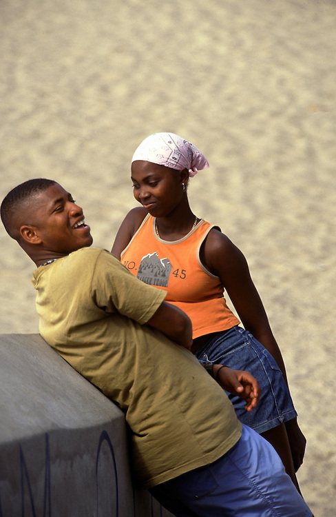 A young boy trying to seduce a young girl in Tarrafal beach.