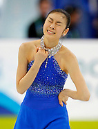 Korea's Kim Yu-Na reacts after her short program in the women's figure skating competition at the 2010 Winter Olympics in Vancouver, Canada on February 25, 2010.  (UPI)