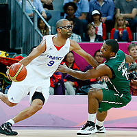 06 August 2012: France Tony Parker drives past Nigeria Chamberlain Oguchi during 79-73 Team France victory over Team Nigeria, during the men's basketball preliminary, at the Basketball Arena, in London, Great Britain.