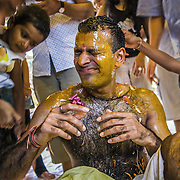 The Haldi ceremony (sometimes called pithi ceremony) can be a lot of fun when things starts getting messy. A groom is drenched in oil and pettles during his destination wedding in Kerala, 2007