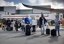 © Licensed to London News Pictures. 17/05/2021. Crawley, UK. Passengers wait to board an EasyJet flight to Faro in Portugal from Gatwick Airport as step three on the roadmap out of lockdown begins. Travel to 12 countries on the green list is allowed from today. Holiday-makers returning home from green listed countries, including Portugal, Gibraltar and Iceland will not have to self-isolate on return. Various hospitality rules are also changing today - with pubs and restaurants allowed to serve seated customers indoors. Photo credit: Peter Macdiarmid/LNP
