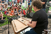 female musician plays a Hammered dulcimer