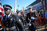 The color guard enters the track area for Friday night's Grand Entry at the 102nd California Rodeo Salinas, which opened July 19 for a four-day run.