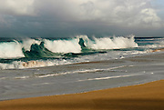 Large waves breaking on the shore on the island of Oahu, Hawaii.