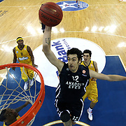 Anadolu Efes's Kerem Gonlum (C) during their Turkish Airlines Euroleague Basketball Top 16 Game 3 Anadolu Efes between Alba Berlin at Abdi Ipekci Arena in Istanbul Turkey on Friday 11 January 2013. Photo by Aykut AKICI/TURKPIX