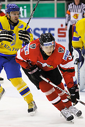 25.04.2010, Eishalle, IJssportcentrum, Tilburg, NED, IIHF Division I WM, Gruppe A, Österreich vs Ukraine im Bild Opening goal scorer Thomas Raffl is checked, EXPA Pictures © 2010, PhotoCredit/ EXPA/ Fintan Planting / SPORTIDA PHOTO AGENCY