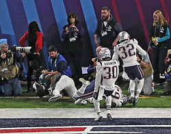 Philadelphia Eagles running back Corey Clement (30), on the ground at left, tumbles out of the end zone after a 22-yard touchdown catch from quarterback Nick Foles in the third quarter on Sunday, February 4, 2018 at U.S. Bank Stadium in Minneapolis, Minn. Defending on the play were Duoin Harmon (30), Devin McCourty (32) and Marquis Flowers (59) of the New England Patriots. Photo by Brian Peterson/Minneapolis Star Tribune/TNS/ABACAPRESS.COM