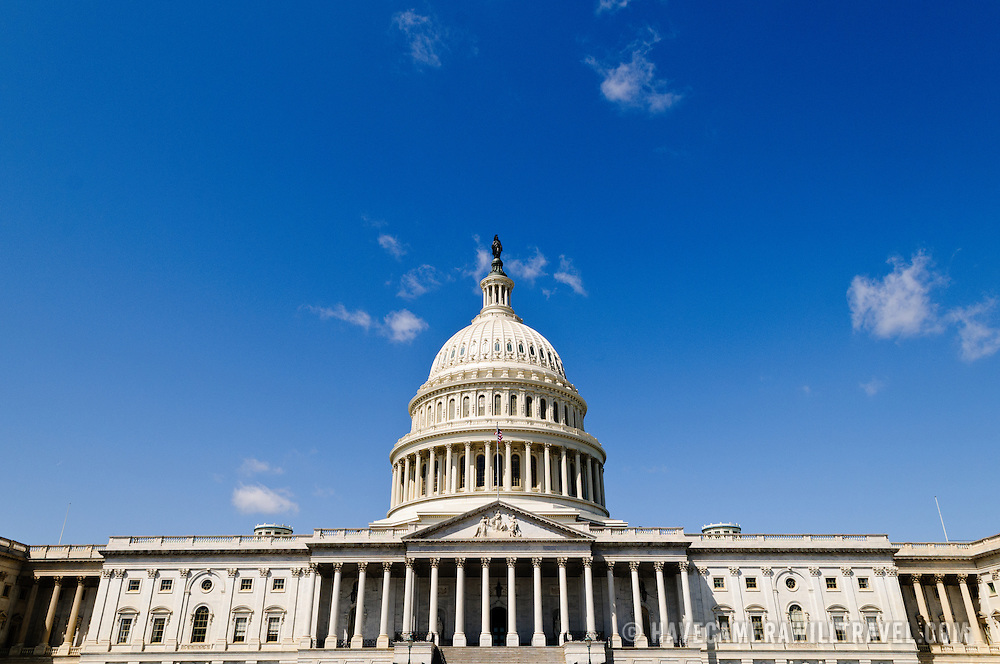 The US Capitol Building against a clear blue sky in Washington DC.