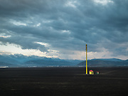A tower in the wide expanse past Xining, in Qinghai province in central China, by the Tibetan Plateau. Life in the train from Hong Kong to Urumqi, Xinjiang.