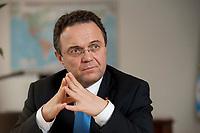 03 JAN 2011, BERLIN/GERMANY:<br /> Hans-Peter Friedrich, MdB, CSU, Vorsitzender der CSU Landesgruppe im Deutschen Bundestag, waehrend einem Interview, in seinem Buero, Jakob-Kaiser-Haus, Deutscher Bundestag<br /> IMAGE: 20110103-01-029