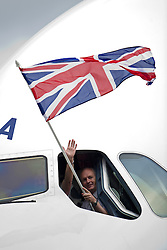 © London News Pictures.  04/07/2013 . London, UK.  A British Airways pilot waves a union flag out of the window of a new British Airways AIRBUS A380 superjumbo as it arrives at Heathrow Airport. It was the first time British Airlines have taken delivery of the new plane, making British Airways the first European airline to operate both the 787 and A380. Photo credit : Ben Cawthra/LNP