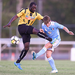 BRISBANE, AUSTRALIA - JANUARY 27: Rhys Raymond of City and Sekou Jomanday of the Jets compete for the ball during the Kappa Silver Boot Third Place match between Moreton Bay United and Brisbane City on January 27, 2018 in Brisbane, Australia. (Photo by Patrick Kearney)
