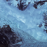 An avalanche tumbles down and icefall on the Lhotse Nup Glacier, beneath [Mount] Lhotse and the Mount Everest massif.