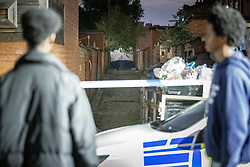 © Licensed to London News Pictures. 26/07/2020. Manchester, UK. A forensic tent erected in a back alley off Henbury Street. A 17 year old boy has been stabbed to death and three others stabbed causing injuries , in the Moss Side area of South Manchester this evening. Photo credit: Joel Goodman/LNP