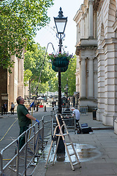© Licensed to London News Pictures. 24/06/2020. London, UK. A gardener waters plants in Downing St. Temperatures are expected to hit 31c today. Photo credit: Ray Tang/LNP