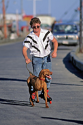 Man Rollerblading With Dog