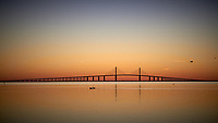 Sunshine Skyway at Dawn on Thanksgiving from Fort Desoto Park in St. Petersburg, Florida. Image taken with a Leica T camera and 18-55 mm lens (ISO 400, 56 mm, f/7.9, 1/250 sec). Raw image processed with Capture One Pro 8, Google Efex Viiveza 2, and Photoshop CC 2104.