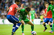 14.09.13. Brondby, Denmark.Alaa Abbulzahra Alazzawi of Irak is chased by Junior Fernández of Chile during the international friendly match at the Brondby Stadium in Denmark.Photo: © Ricardo Ramirez