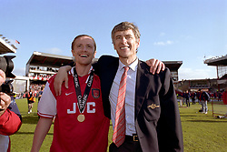 FILE PHOTO: Arsene Wenger is to leave Arsenal at the end of the season, ending a near 22-year reign as manager<br /><br />l-r  Arsenal's Emmanuel Petit (left) and Arsenal manager Arsene Wenger (right) celebrate winning the FA Carling Premiership  ... Soccer - FA Carling Premiership - Arsenal v Everton  ... 03-05-1998 ...   ... None ... Photo credit should read: Tony Marshall/EMPICS Sport. Unique Reference No. 274815 ... Soccer - Premiership - Arsenal v Everton<br />Arsenal's Emmanuel <br />Petit (l) and manager <br />Arsene Wenger (r) <br />celebrate