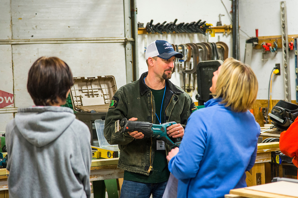 Participants in the Michigan DNR Becoming an Outdoors Woman program learn about power tools at Bay Cliff Health Camp in Big Bay, Michigan.