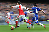 Mesut Ozil of Arsenal and Pedro of Chelsea in action. Premier league match, Chelsea v Arsenal at Stamford Bridge in London on Saturday 4th February 2017.<br /> pic by John Patrick Fletcher, Andrew Orchard sports photography.