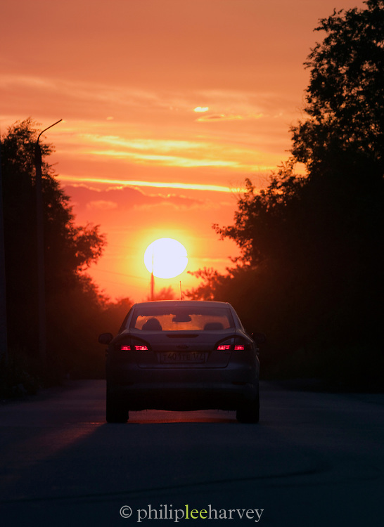 Rear of a car driving towards sunset, Ekaterinburg, Russia