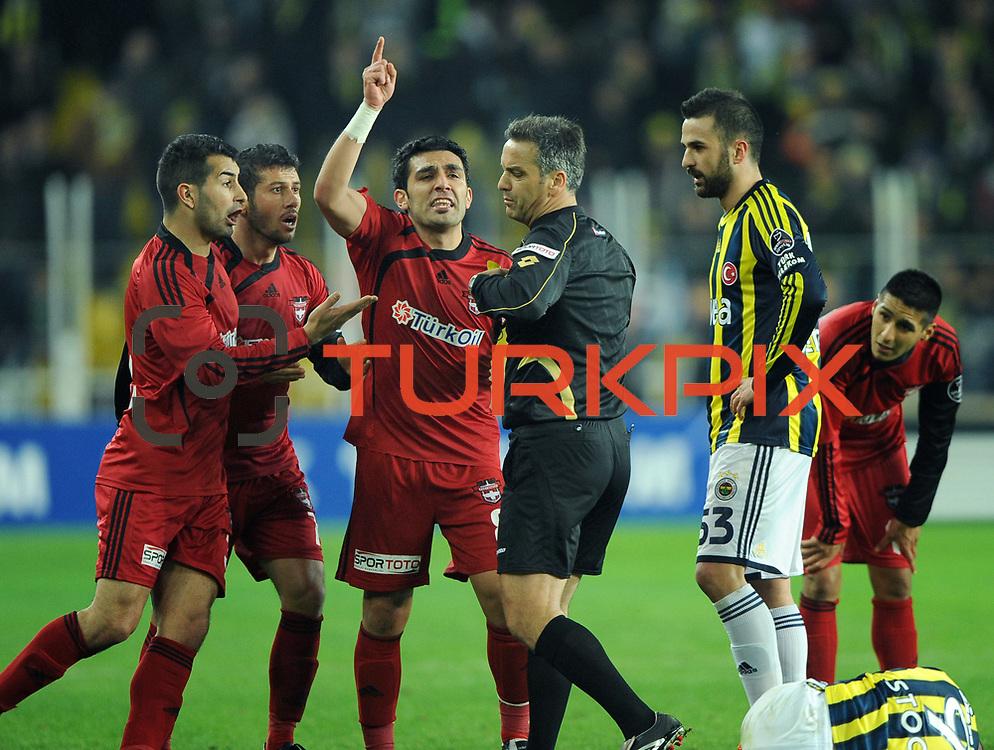 Referee's Mustafa Kamil Abitoglu (C) during their Turkish superleague soccer match Fenerbahce between Gaziantepspor at the Sukru Saracaoglu stadium in Istanbul Turkey on Monday09 January 2011. Photo by TURKPIX