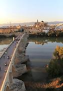 Roman bridge river Rio Guadalquivir with Mezquita cathedral buildings, Cordoba, Spain