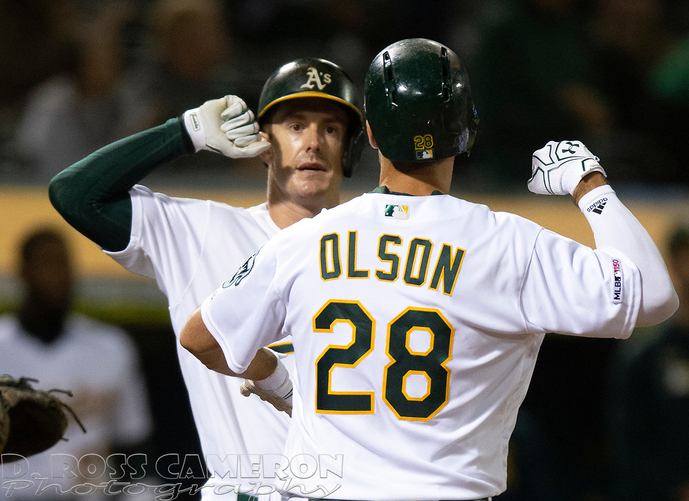 Sep 17, 2019; Oakland, CA, USA; Oakland Athletics Matt Olson (28) celebrates his solo home run with teammate Mark Canha during the seventh inning of a baseball game against the Kansas City Royals at Oakland Coliseum. Mandatory Credit: D. Ross Cameron-USA TODAY Sports