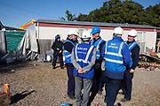 Bailiffs discuss tactics at Dale Farm site prior to eviction. Riot police and bailiffs were present on 20th October 2011, as the site was cleared of the last protesters chained to barricades. Dale Farm is part of a Romany Gypsy and Irish Traveller site in Crays Hill, Essex, UK<br /> <br /> Dale Farm housed over 1,000 people, the largest Traveller concentration in the UK. The whole of the site is owned by residents and is located within the Green Belt. It is in two parts: in one, residents constructed buildings with planning permission to do so; in the other, residents were refused planning permission due to the green belt policy, and built on the site anyway.