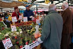 Outdoor fruit and vegetable market near Rialto Bridge in Venice Italy
