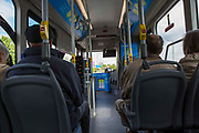 Inside one of Nottingham's zero emissions Ecolink buses in Nottingham, Nottinghamshire, United Kingdom. The electric buses are part of the City Council's campaign to reduce noise and air pollution in the city centre, while still providing accessible public transport.