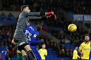 Angus Gunn, the Norwich city goalkeeper punches clear from Junior Hoilett of Cardiff city .EFL Skybet championship match, Cardiff city v Norwich city at the Cardiff city stadium in Cardiff, South Wales on Friday 1st December 2017.<br /> pic by Andrew Orchard, Andrew Orchard sports photography.