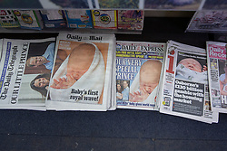 © licensed to London News Pictures. London, UK 24/07/2013. Newspaper front pages showing Royal Baby pictures on Wednesday, July 24, 2013, the day after Duke and Duchess of Cambridge leave the hospital and reveal their son for the first time. Photo credit: Tolga Akmen/LNP